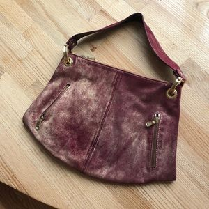 Hand bag, color is pinkish red with gold glitter.